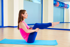 Pilates woman open leg rocker exercise workout Stock Images