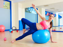 Pilates woman passes fitball exercise workout. At gym indoor swiss ball Stock Images