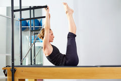 Pilates woman in reformer exercise at gym Stock Photo