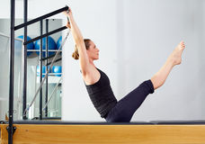 Pilates woman in reformer teaser exercise at gym Royalty Free Stock Images