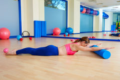 Pilates woman roller swan roll exercise workout Royalty Free Stock Photos