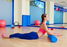 Pilates woman roller swan roll exercise workout Royalty Free Stock Photography