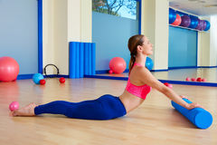 Pilates woman roller swan roll exercise workout Stock Photos