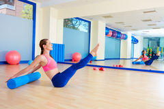 Pilates woman roller teaser roll exercise workout Stock Photo