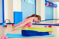 Pilates woman rowing rubber band exercise. Workout at gym indoor Royalty Free Stock Image