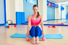 Pilates woman sand balls exercise workout at gym. Indoor Stock Photo