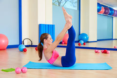 Pilates woman scissor exercise workout at gym. Indoor Royalty Free Stock Images