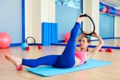 Pilates woman scissor magic ring exercise workout Stock Photo