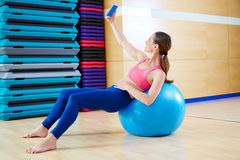 Pilates woman shoots selfie mobile self portrait Royalty Free Stock Photography