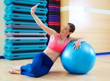 Pilates woman shoots selfie mobile self portrait Royalty Free Stock Image