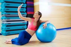 Pilates woman shoots selfie mobile self portrait Stock Images