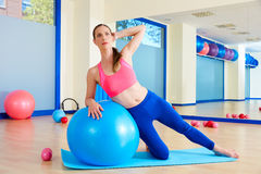 Pilates woman side bend fitball exercise Royalty Free Stock Images