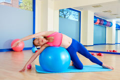 Pilates woman side bend fitball exercise Stock Photography