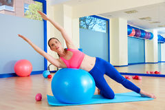 Pilates woman side bend fitball exercise Royalty Free Stock Photography