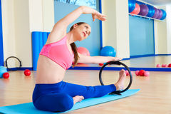 Pilates woman side stretch magic ring exercise. Workout at gym indoor Royalty Free Stock Images