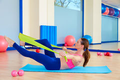 Pilates woman single leg stretch rubber band Stock Image