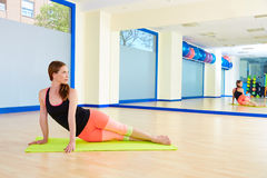 Pilates woman snake exercise workout at gym Royalty Free Stock Photo