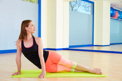 Pilates woman snake exercise workout at gym Royalty Free Stock Photography