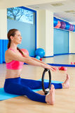 Pilates woman spine stretch forward magic ring. Exercise workout at gym indoor Stock Photos