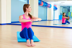 Pilates woman spine twist exercise workout at gym. Indoor Royalty Free Stock Photos
