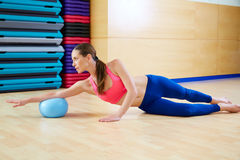 Pilates woman stability ball exercise gym workout. Pilates woman stability ball exercise workout at gym indoor Royalty Free Stock Photo
