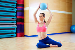 Pilates woman stability ball exercise gym workout. Pilates woman stability ball exercise workout at gym indoor Royalty Free Stock Photos