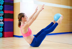 Pilates woman stability ball teaser exercise Stock Images