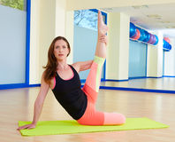 Pilates woman stretching exercise workout at gym. Indoor Stock Image