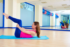 Pilates woman stretching exercise workout at gym. Indoor Stock Images