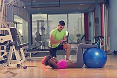Pilates  workout with personal trainer at gym Royalty Free Stock Photography
