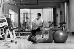 Pilates  workout with personal trainer at gym Stock Photography