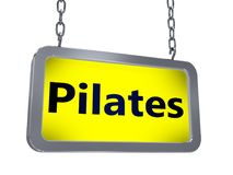 Pilates on billboard. Pilates on yellow light box billboard on white background Royalty Free Stock Photos