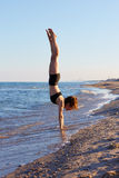 Pilates yoga workout exercise outdoor on beach Royalty Free Stock Photography