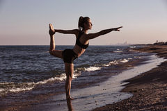 Pilates yoga workout exercise outdoor on beach Royalty Free Stock Image
