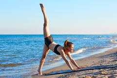 Pilates yoga workout exercise outdoor on beach Stock Photography