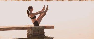 Pilates yoga workout exercise outdoor Stock Photo