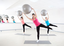 Pilates. Young women doing exercise with Pilates ball in fitness gym Royalty Free Stock Image
