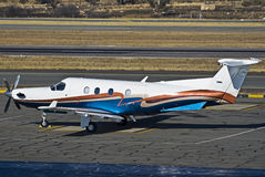 Pilatus PC-12/45. A 1999 model, Pilatus PC-12/45 parked on the the apron. Seen here sporting it's new (2007) paint job Royalty Free Stock Image