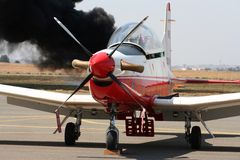 Pilatus PC7. With a fire in the background at an airshow in South Africa Stock Photography