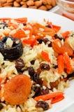 Pilau gemaakte ââof rijst en droge vruchten. Stock Foto