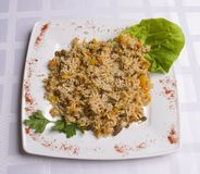 Pilau with lamb. On white plate Royalty Free Stock Image