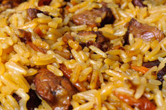 Pilau (pilaw, plov) - a rice and meat meal macro. Close-up Royalty Free Stock Photos
