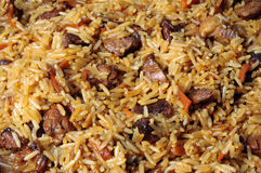Pilau, pilaw, plov - a rice and meat meal macro. Close-up Royalty Free Stock Photos