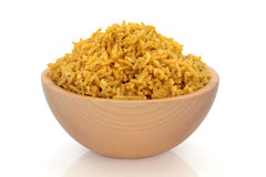 Pilau Rice. Cooked pilau spiced rice in a beech wood bowl, over white background Royalty Free Stock Photography