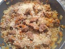 Pilav matlagning royaltyfria bilder
