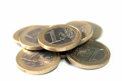 Pile of 1 Euro coins. Isolated over a white background stock photography