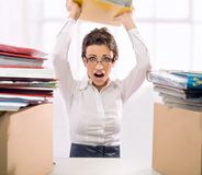 Pile. Angry businesswoman, pile of documents royalty free stock image