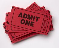 Pile of Admit One tickets. Close up shot of red admit one tickets shot on white with soft drop shadow stock photos