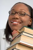 On the pile - adult education. Female Student rests her head on stack of books Stock Image