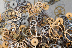 Pile of aged gears cogwheels macro view. Steampunk mechanical equipment and mechanism background. Shabby grunge scratch Royalty Free Stock Image